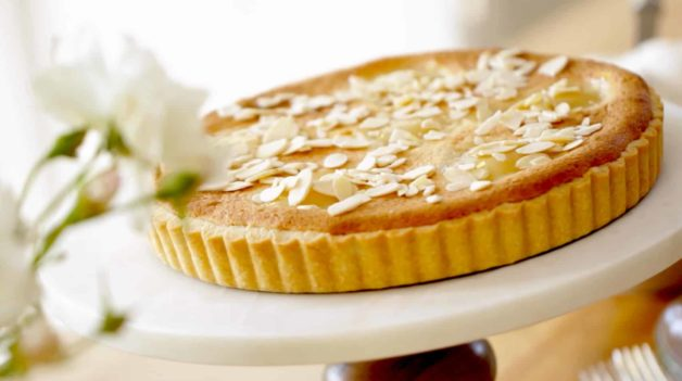 Pear and Almond Tart Recipe served on a white cake stand