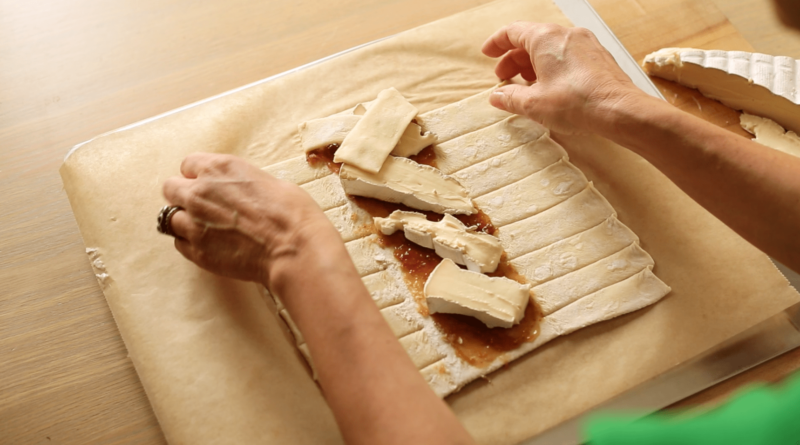 Creating a braid of fig and brie cheese on puff pastry for the 3 Puff Pastry Appetizer Ideas