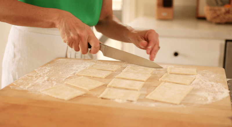 Cutting pastry for mushroom tarts for 3 Puff Pastry Appetizer Ideas