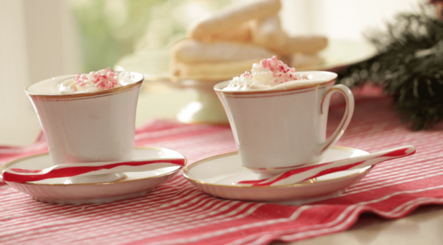 two tea cups of Peppermint Hot Chocolate on a red tablecloth