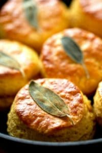 sage leaves baked on top of a recipe for how to make sweet potato biscuits