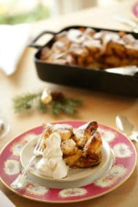Panettone Bread Pudding Recipe with a serving sliced on plate
