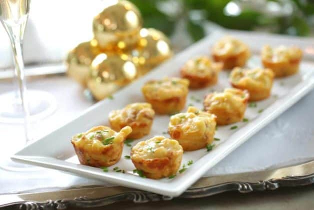 Bacon Mac and Cheese Bites on a rectangular platter garnished with chives