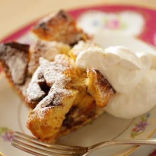 Bread Pudding Recipe served on a plate with whipped cream