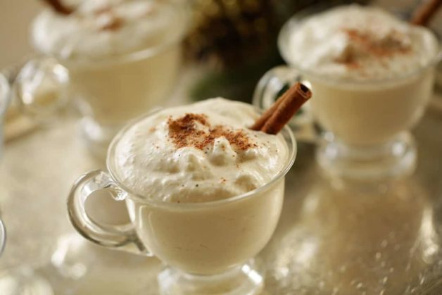 Eggnog Recipe on a silver tray in a glass punch cup