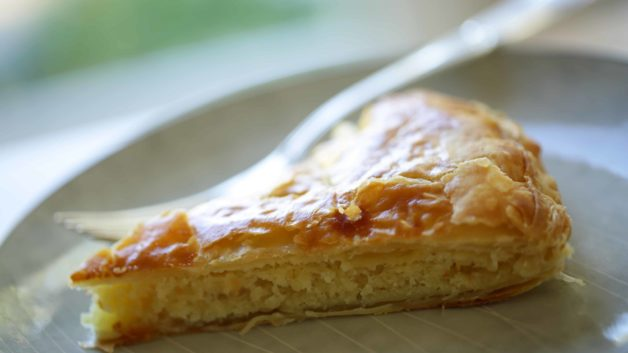 a slice of Galette des Rois cake on a plate with fork