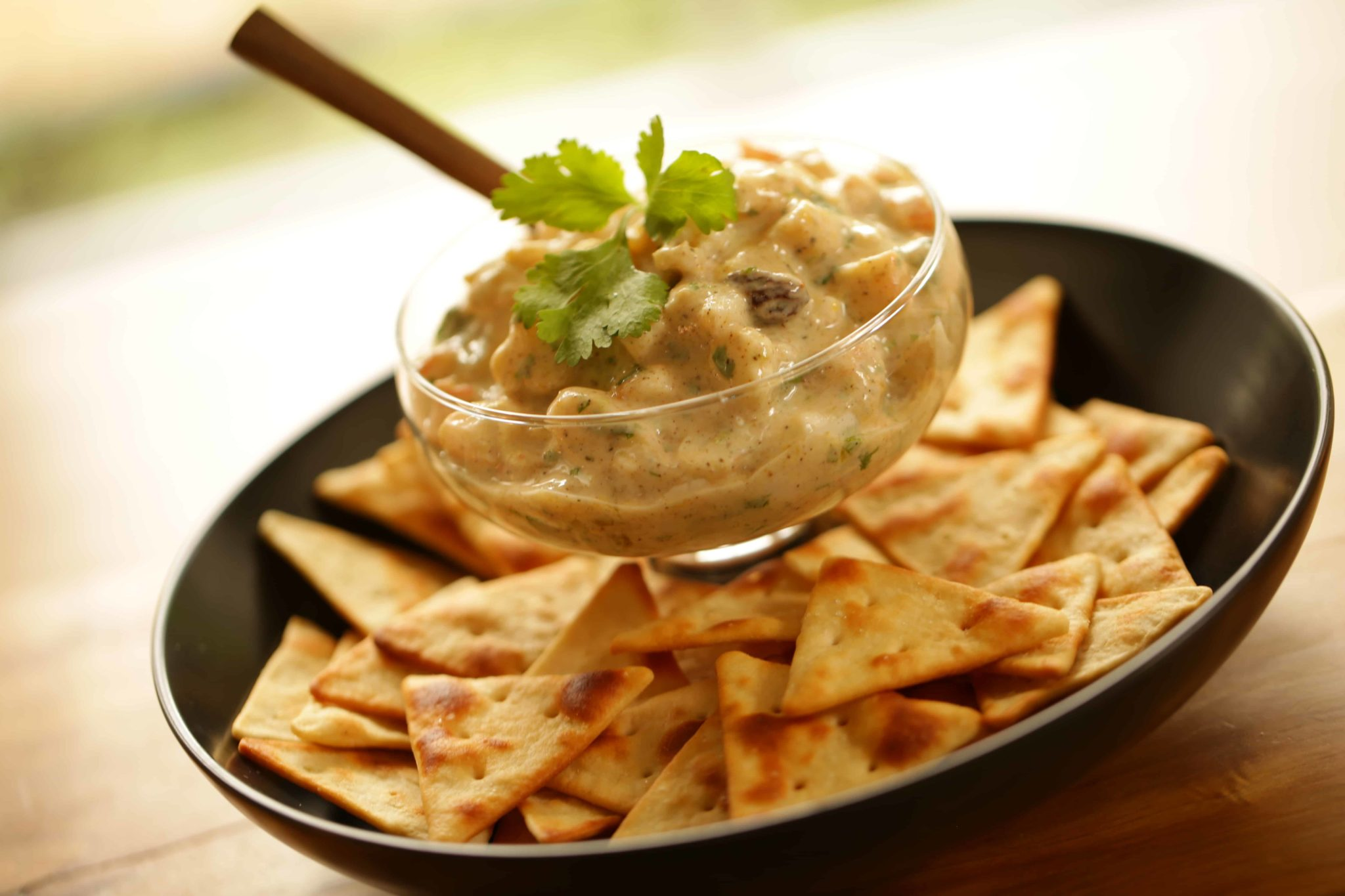 Sweet and Spicy Shrimp Dip in a bowl with pita crackers