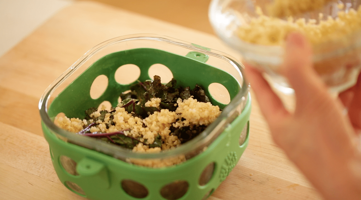 Adding Quinoa to kale in a lunch box container