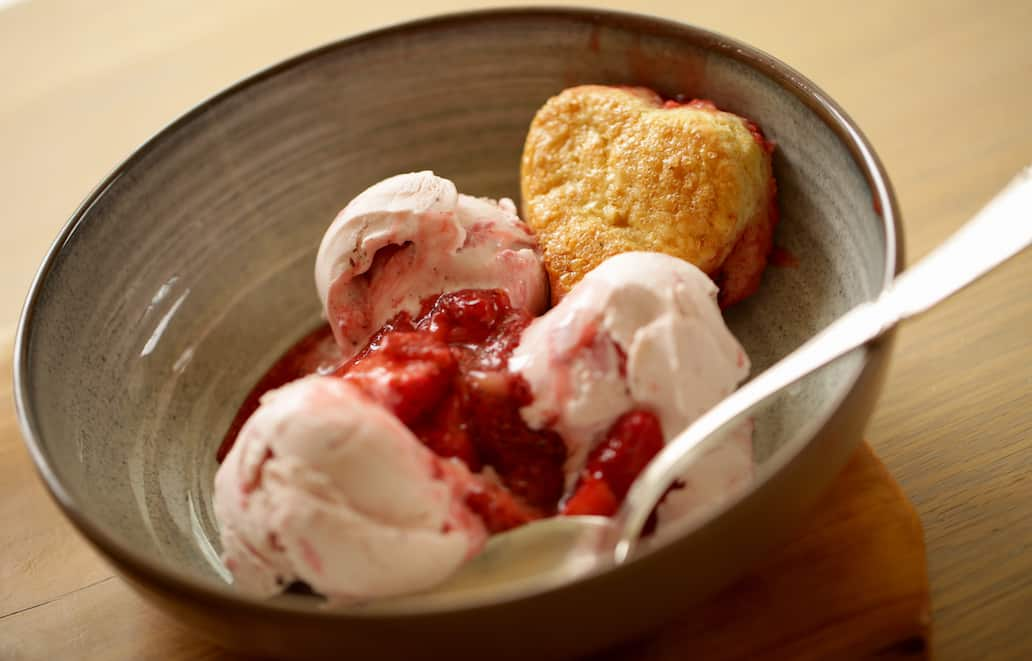 Strawberry Cobbler with Heart Shaped Biscuits in a bowl with Strawberry Ice Cream