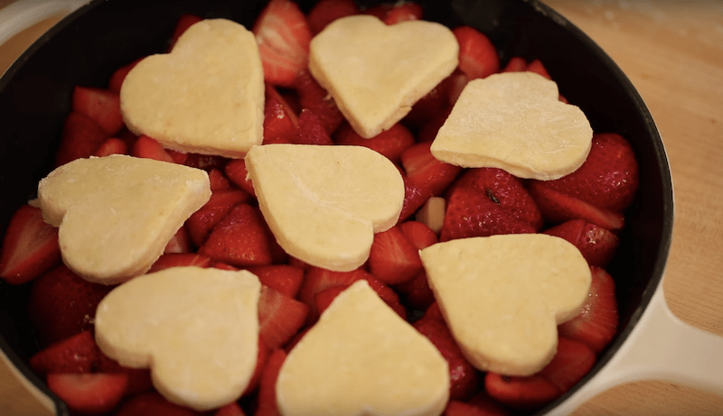 strawberry cobbler ready to go into the oven for a how to make strawberry cobbler recipe