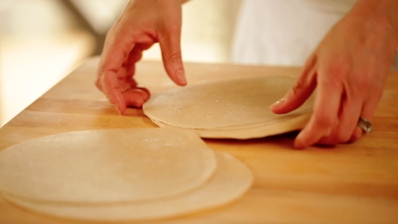 tortillas being prepared on a wood surface for a Veggie Quesadilla Recipe with Chunky Gaucomole