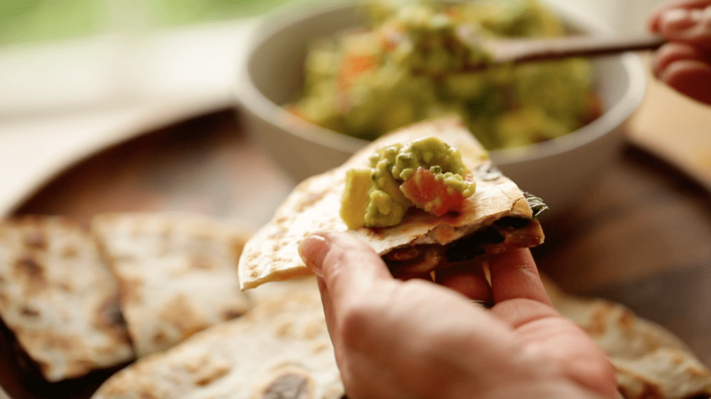 guacamole on top of a veggie quesadilla recipe