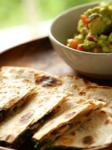 Veggie Quesadillas on a platter with Guacamole