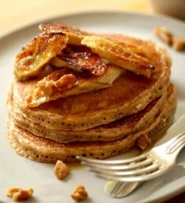 close up of Banana Pancake Recipe served on a large plate with a knife and fork