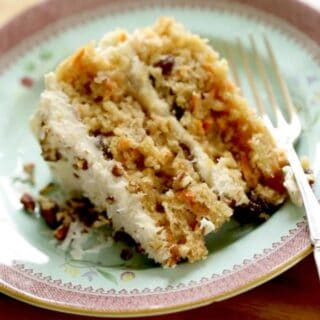 the best carrot cake recipe slice on a blue and purple plate with a fork
