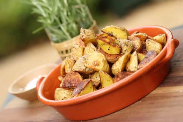 Beth's Foolproof Roasted Potatoes in a terra cotta dish