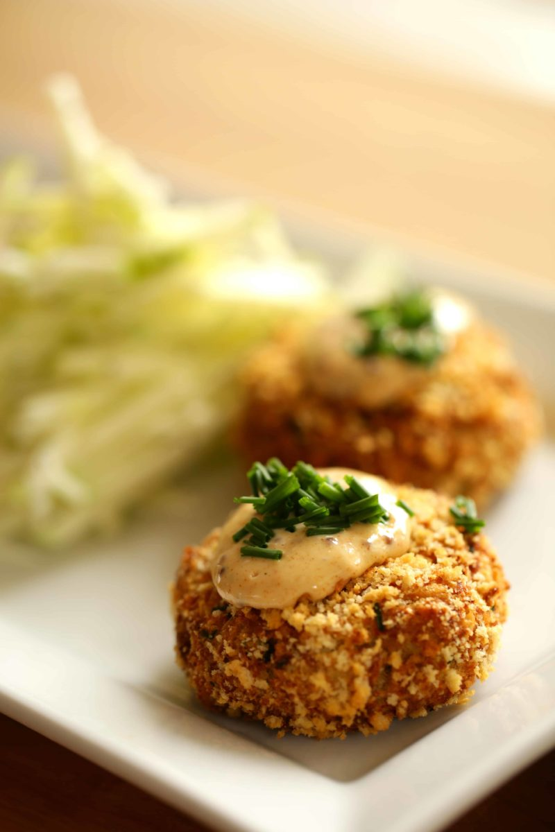 Easy Crab Cake Recipe served on a square white plate with apple slaw