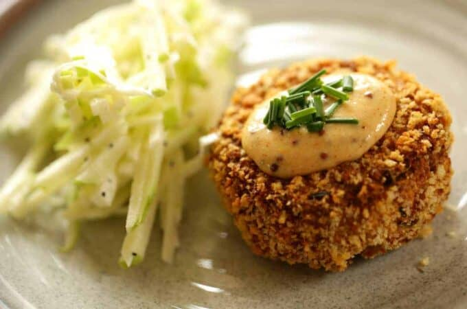 Easy Crab Cake Recipe served on a light green plate with apple slaw