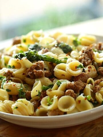 A bowl of pasta with sausage and broccoli