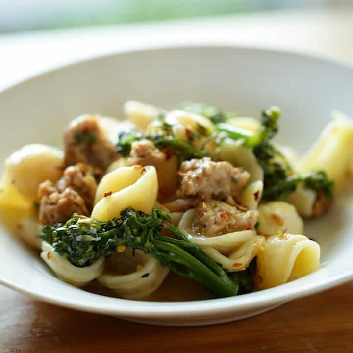 Pasta with Sausage and Broccoli in a white bowl