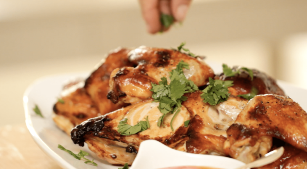 Sprinkling cilantro on a Soy Glazed Roast Chicken Recipe