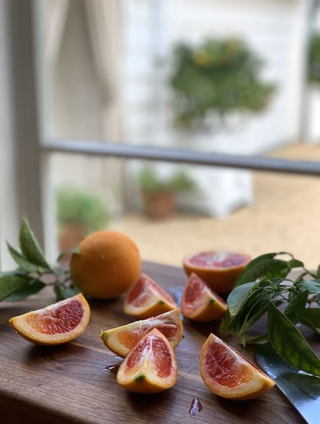 Blood Oranges Sliced on Board in front of window