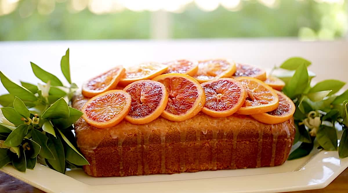 Blood Orange Pound Cake decorated with citrus blossoms