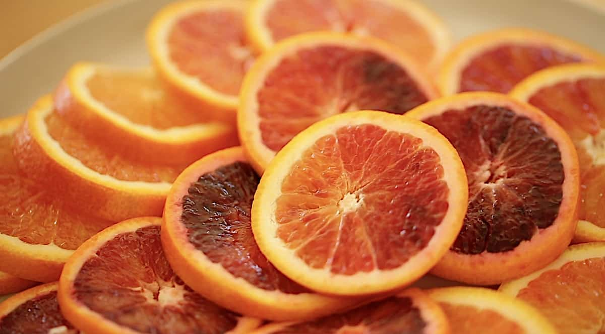 a display of blood orange slices showing the variance in color
