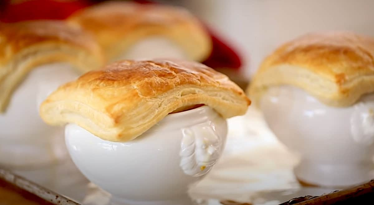 White lions head bowls covered with a square of baked puff pastry
