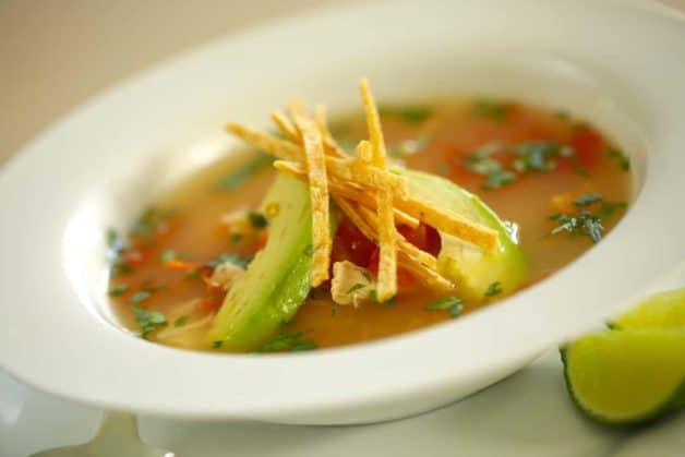 Easy Tortilla Chicken Soup Recipe in a white bowl
