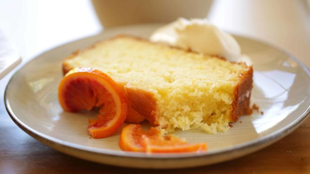 Slice of Blood Orange Pound Cake with whipped cream dollop