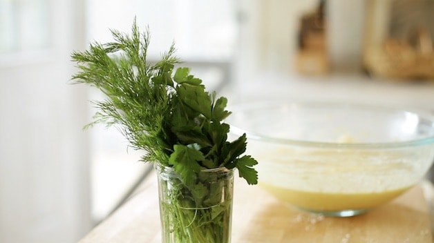 Fresh spring herbs in a glass of water