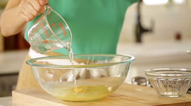 Adding water from a Pyrex Pitcher to a large Mixing Bowl