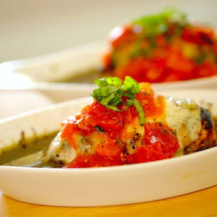 two pesto chicken bakes in a gratin dish