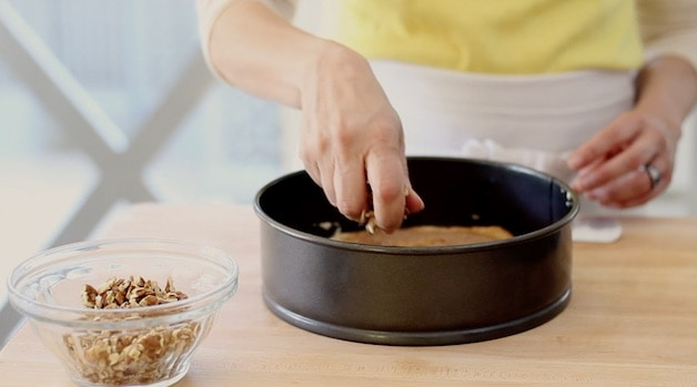 adding crumb topping to a coffee cake batter