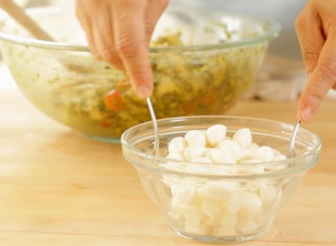 Straining fresh mozzarella for Cold Italian Tortellini Salad