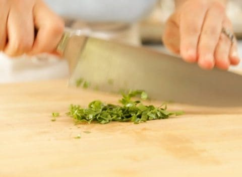 Chopping herbs for Cold Italian Tortellini Salad