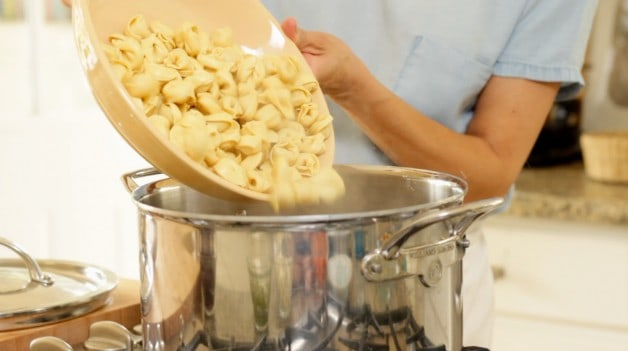 Tortellini poured into pot of boiling water for Cold Italian Tortellini Salad