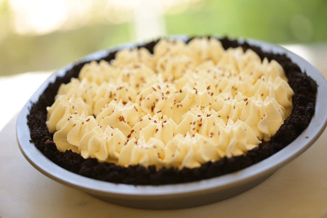 Chocolate Cream Pie in tin on cutting board