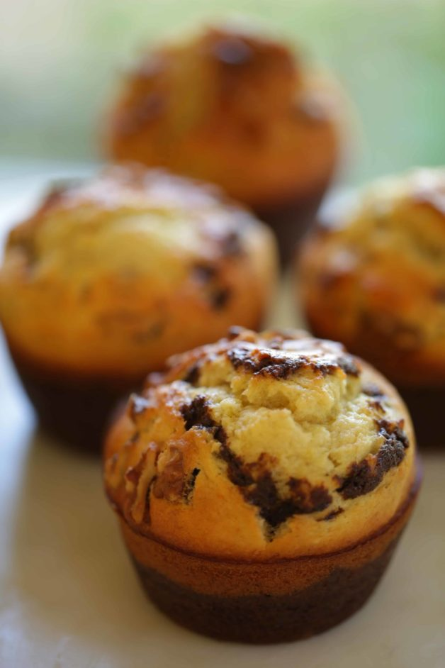 Black Bottom Banana Nut Muffins on a cake stand vertical image