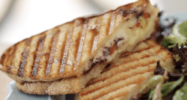 Vegetarian Panini sliced open showing cheese and fillings