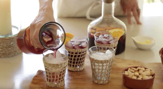 Non-alcoholic sangria being poured into glasses filled with ice
