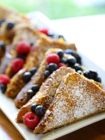 Brioche French Toast with Berries on a White Plate