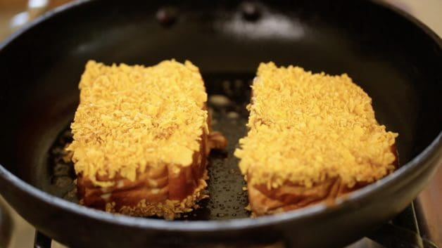 Crunchy Brioche French Toast recipe frying in a pan