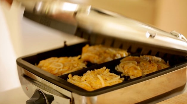 Hash brown Waffles being pressed on waffle iron
