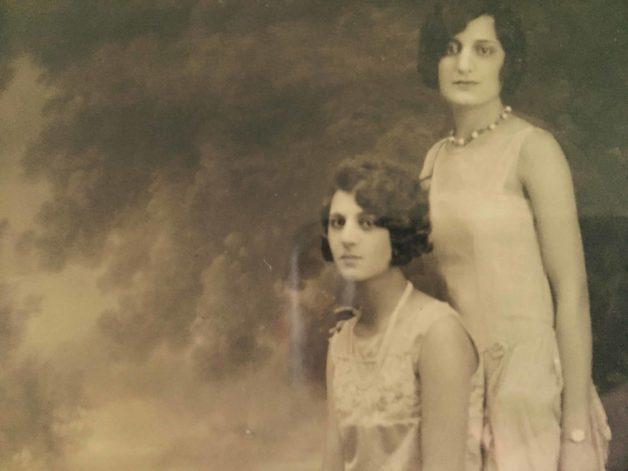 A vintage photo of Two Italian Women in fancy dresses