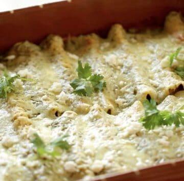 Enchiladas Suizas Recipe baked in a rectangular terra cotta casserole dish