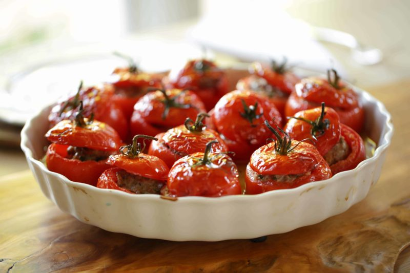 Roasted Stuffed Tomatoes in a white gratin dish