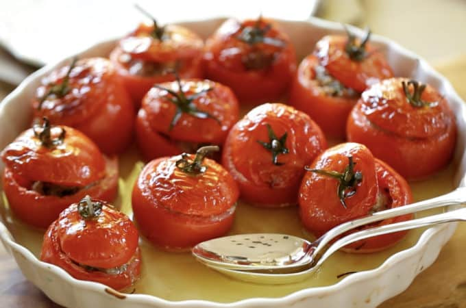 Beth's Tomate Farcie Recipe in a white serving platter with a silver serving spoons
