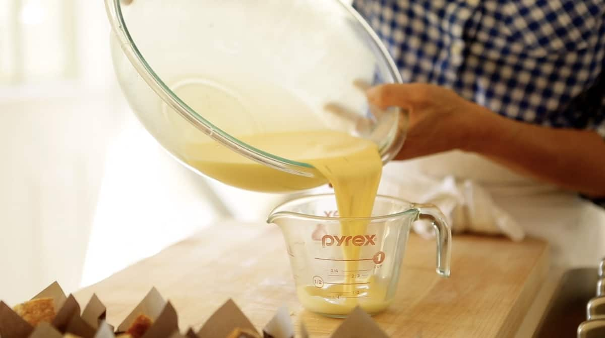 Pouring egg custard into a pyrex pitcher